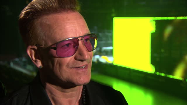 interior interview with bono and the edge of u2 about their release of a free album on apple and issues around artists being paid on may 15 2015 in... - david 'the edge' howell evans stock videos and b-roll footage