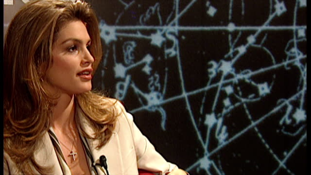 vídeos de stock, filmes e b-roll de interior interview with cindy crawford reacting in surprise as she is asked if she is getting married she responds don't believe everything you read... - model t