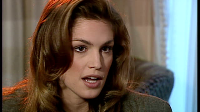 interior interview with cindy crawford speaking about wanting to present people with something achievable in her exercise video, and the pressure to... - cindy crawford stock videos & royalty-free footage
