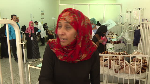 interior interview with dr najla alsonboli head of paediatrics at sa'ada hospital about children coming to the hospital with illnesses such as... - whooping cough stock videos and b-roll footage