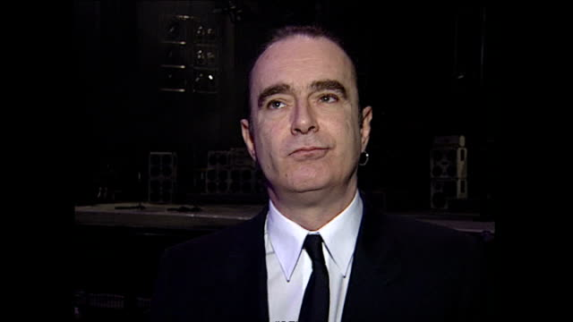 Interior interview with Francis Rossi speaking about Status Quo working with the Beach Boys at the Brixton Academy on January 28 1996 in London...