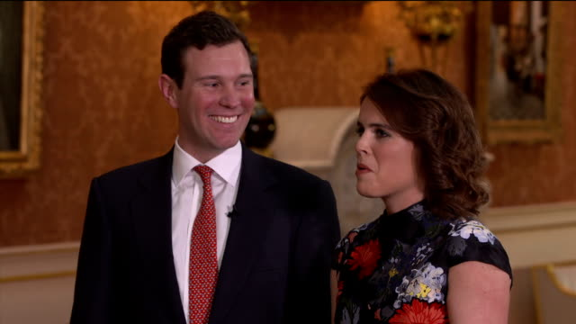 vídeos de stock e filmes b-roll de interior interview with jack brooksbank and princess eugenie speaking about their engagement saying that it was a perfect moment and that the queen... - princesa