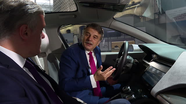 vídeos de stock, filmes e b-roll de interior interview with jaguar land rover chief executive dr ralf speth speaking about the importance of the automotive industry working with other... - veículo com combustível alternativo
