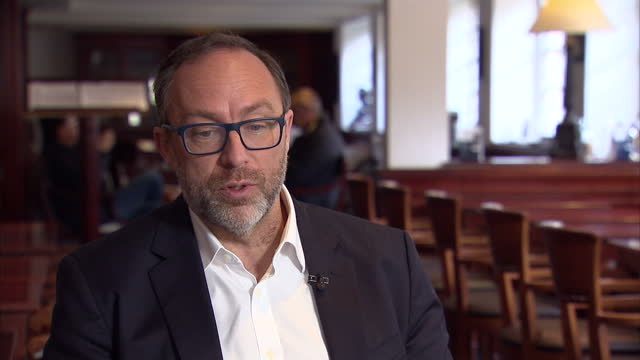 interior interview with jimmy wales founder of wikipedia and wikitribune speaking about the issue of fake news and the influence of advertising in... - artificial stock videos & royalty-free footage