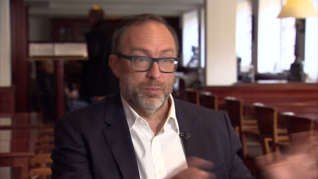 interior interview with jimmy wales founder of wikipedia and wikitribune speaking about how wikitribune will differ from most digital news outlets by... - subscribe stock videos and b-roll footage