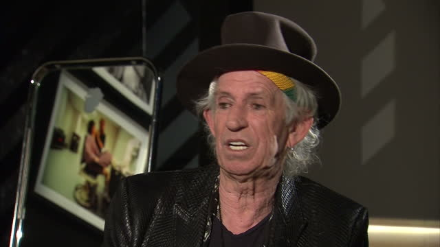 interior interview with keith richards speaking about how he and other members of the rolling stones have had to learn how to cope with fame over the... - rolling stones stock videos & royalty-free footage