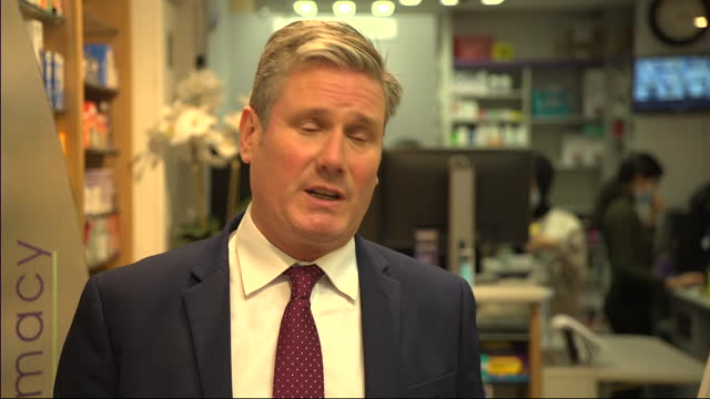 GBR: Labour Leader Sir Ker Starmer visits a pharmacy vaccination centre in London