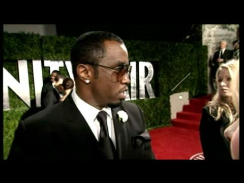 vídeos de stock, filmes e b-roll de interior interview with p diddy, rapper - festa do oscar