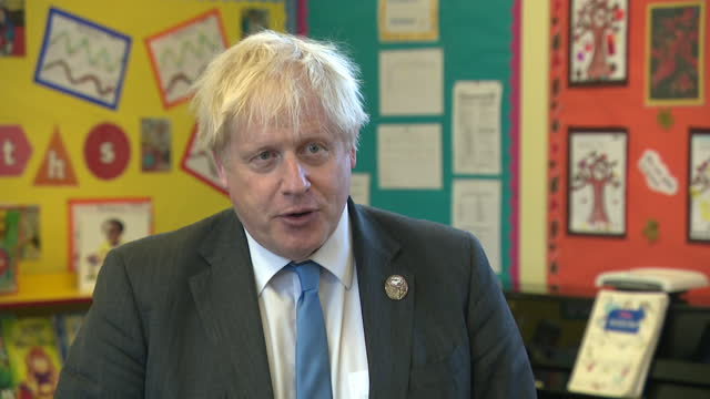 GBR: Prime Minister Boris Johnson attends 'A Service of Reflection' and a local primary school in Northern Ireland