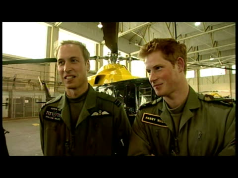 interior interview with prince harry and prince william, predominantly with harry discussing his flight training and his hope of flying helicopters... - balding stock videos & royalty-free footage