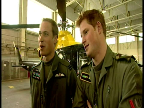 interior interview with prince william and prince harry discussing living together whilst being on their military helicopter training courses. prince... - balding stock videos & royalty-free footage