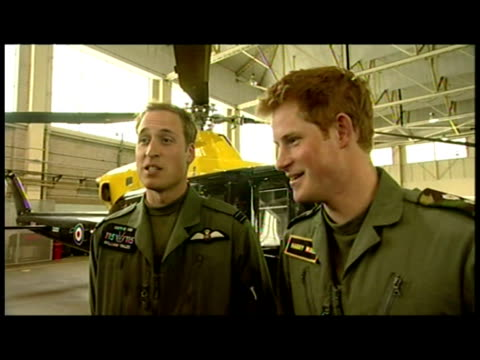 interior interview with prince william and prince harry talking about their training and joking about each other's hair. prince william & prince... - balding stock videos & royalty-free footage