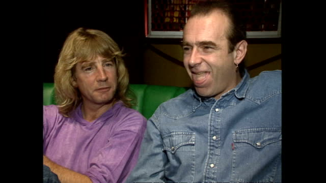 interior interview with rick parfitt and francis rossi talking about what it is like to be back at butlins where they used to work when they met on... - butlins stock videos and b-roll footage