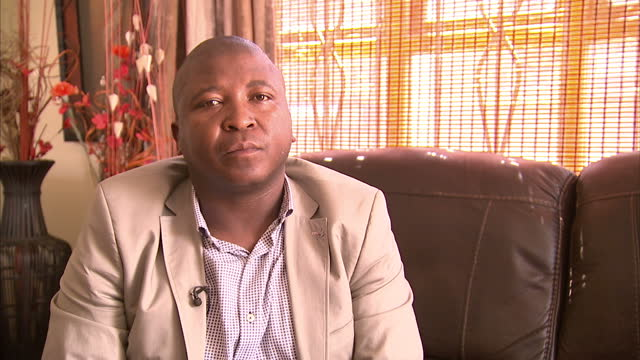 Interior interview with sign language interpreter Thamsanqa Jantjie speaking about why he was chosen to provide sign interpretation at the memorial...