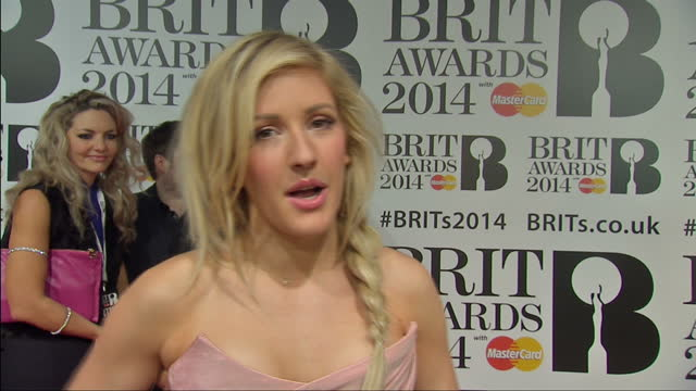 vídeos de stock, filmes e b-roll de interior interview with singer ellie goulding on the red carpet at the 2014 brit awards speaking about feeling confident about her nominations in... - ellie goulding