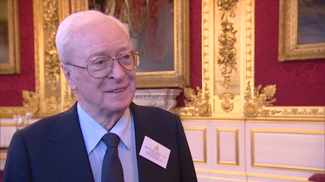 vídeos de stock e filmes b-roll de interior interview with sir michael caine speaking about how having experience of acing in theatre is a contributing factor to the success of many... - michael caine ator
