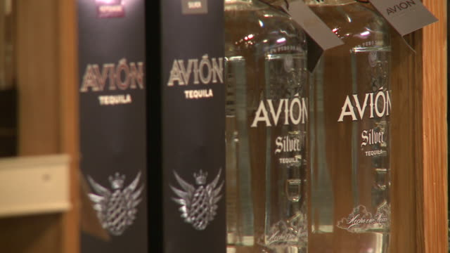 interior k&d wines & spirits, wine of display, side angle of avion tequila, multiple shots, avion on store shelf - avion stock-videos und b-roll-filmmaterial