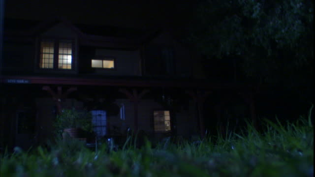 interior lights illuminate the windows of a house. - grounds stock videos & royalty-free footage