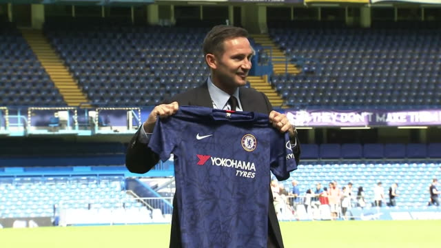 interior new chelsea manager frank lampard holds the home shirt as he is announced as new manager of chelsea fc at stamford bridge on 4th july 2019... - shirt stock videos & royalty-free footage