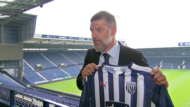 interior new west brom salven bilic holds the home shirt as he is announced as new manager of west brom at the hawthorns on 24th june 2019 in west... - shirt stock videos & royalty-free footage