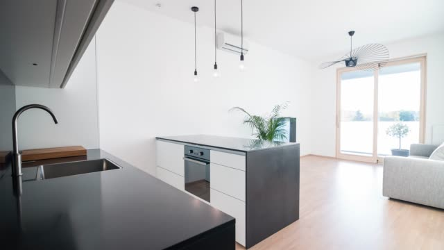 interior of a contemporary apartment - kitchen worktop stock videos & royalty-free footage