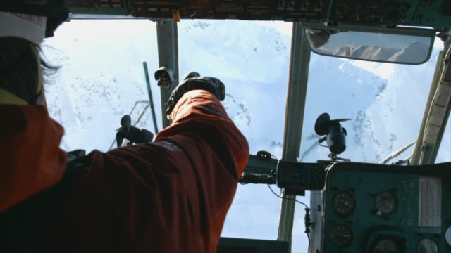 interior of a helicopter cockpit going skiing mountains. - helicopter tour stock videos and b-roll footage