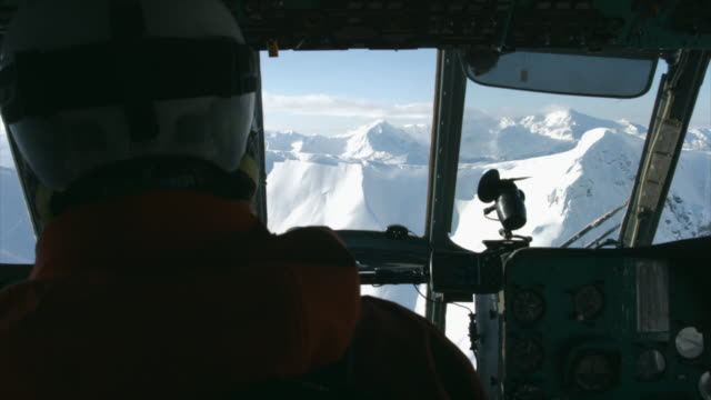 interior of a helicopter cockpit going skiing mountains. - pilot stock-videos und b-roll-filmmaterial