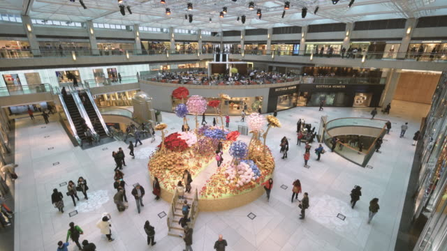 interior of a large shopping mall in hong kong - real time stock videos & royalty-free footage
