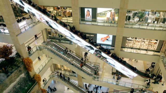 interior of a shopping mall,xi'an,china. - centro commerciale suburbano video stock e b–roll