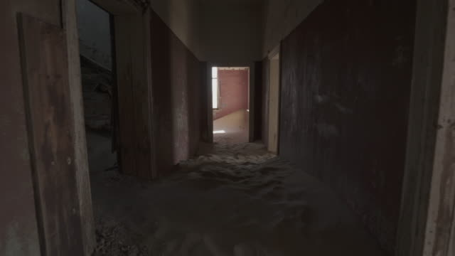 interior of abandoned house with sand in rooms and corridor - kolmanskop, namibia - doorway stock videos & royalty-free footage