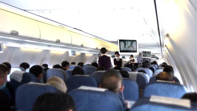 interior of aircraft - air stewardess stock videos & royalty-free footage
