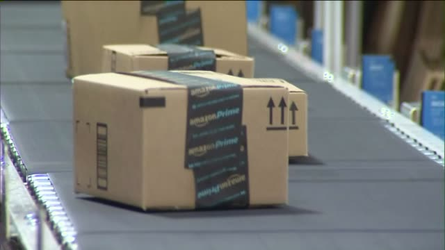 ktla interior of amazon warehouse in san bernardino shots of packages going down conveyor belt - e commerce stock videos & royalty-free footage