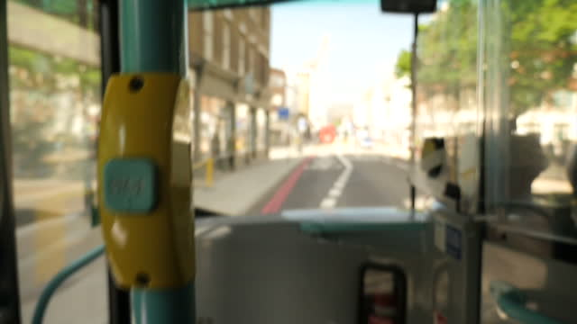 interior of an iconic red london bus with features such as the 'stopping' sign lighting up anon views of people's legs and feet stepping onto the bus... - disability icon stock videos & royalty-free footage