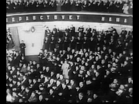 ws interior of bolshoi theatre in moscow with crowds attending for celebration of joseph stalin's 70th birthday / stalin arrives at rostrum on... - ehemalige sowjetunion stock-videos und b-roll-filmmaterial