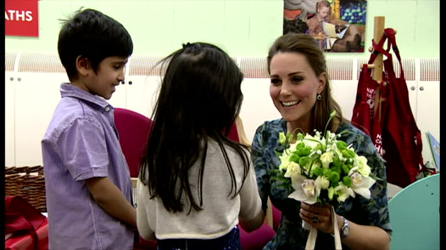 interior of catherine, duchess of cambridge being given flowers by two young children on february 18, 2015 in smethwick, england. - peerage title stock videos & royalty-free footage