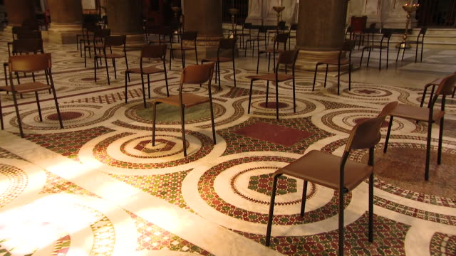 interior of church in rome during coronavirus lockdown, roped off and chairs separated for social distancing - roped off stock videos & royalty-free footage