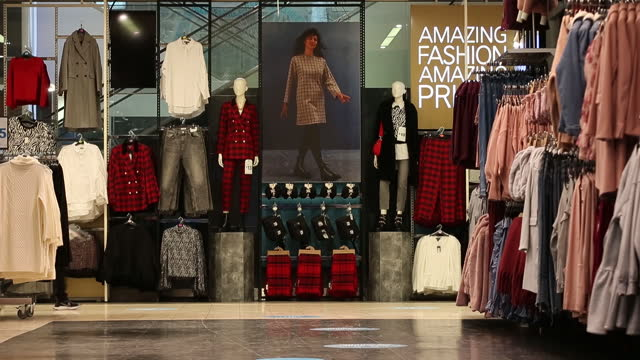 interior of clothing store at oxford street in city of london, london, england, u.k., on wednesday, december 2, 2020. most of england's retailers are... - clothes shop stock videos & royalty-free footage