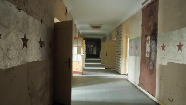 "interior of corridor in wunsdorf a soviet military garrison abandoned outside of berlin - ""bbc news"" stock-videos und b-roll-filmmaterial"
