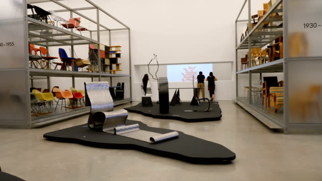 interior of design museum gallery with people watching video exhibition - museum stock videos & royalty-free footage