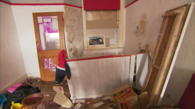 interior of dilapidated run down house that was owned by private slum landlord blackpool - 老朽化点の映像素材/bロール