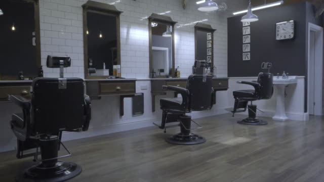 interior of empty barber shop as it is closed during the coronavirus lockdown - barber stock videos & royalty-free footage