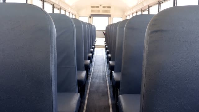 interior of empty school bus - education stock videos & royalty-free footage
