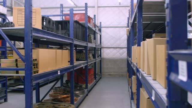 interior of factory warehouse with long shelves - compartment stock videos & royalty-free footage