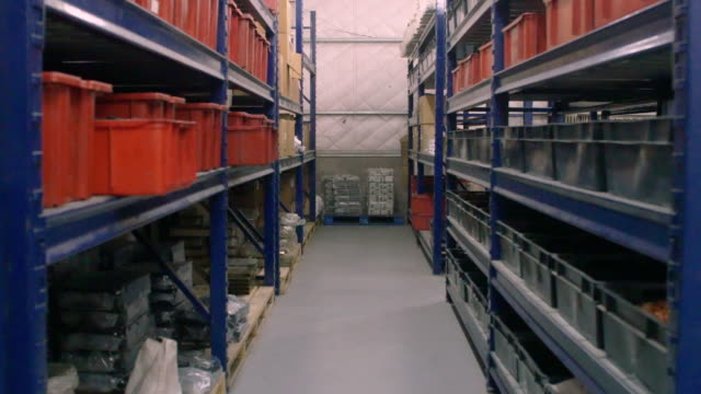 interior of factory warehouse with long shelves - storage compartment stock videos and b-roll footage
