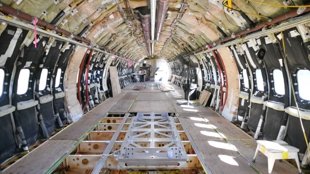 interior of firefighting airplane under construction at coulson aviation, where they retrofit and upgrade both fixed wing and helicopter aircraft... - air vehicle stock videos & royalty-free footage