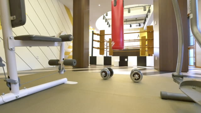 interior of gym in modern villa 4k - exercise equipment stock videos and b-roll footage