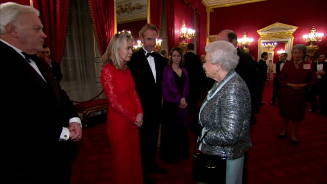 interior of her majesty queen elizabeth ii meeting genesis musician mike rutherford and his wife angie rutherford on february 17 2015 in london... - mike rutherford stock videos & royalty-free footage