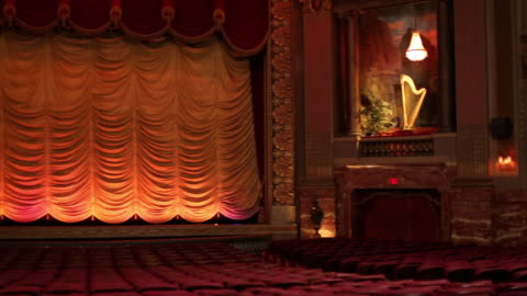 ws pan interior of historic movie theater, from audience perspective / richmond, virginia, usa - theatre building stock videos & royalty-free footage