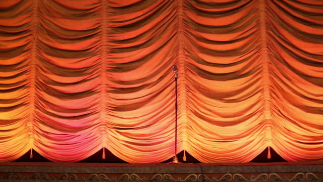 MS Interior of Historic Movie Theater, Spotlight Scans Wildly Onto Old Microphone on Stage / Richmond, Virginia, USA