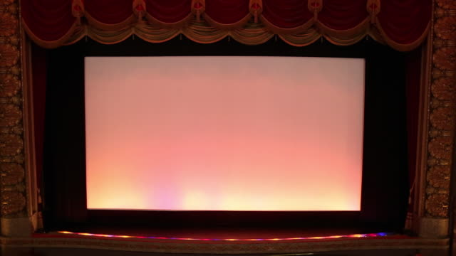 ws tu interior of historic movie theater, stage curtain falls / richmond, virginia, usa - projection screen stock videos and b-roll footage